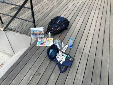 Painting kit on the Vltava River dock
