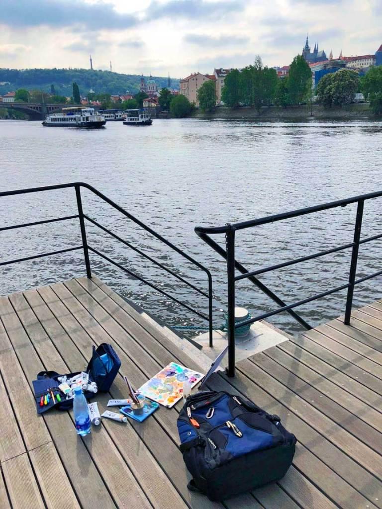 Painting kit on the Vltava River dock
