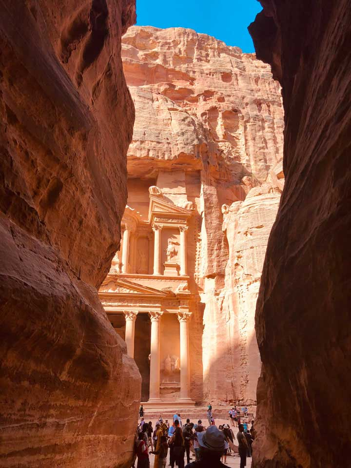 The Treasury comes into view while walking through the Siq