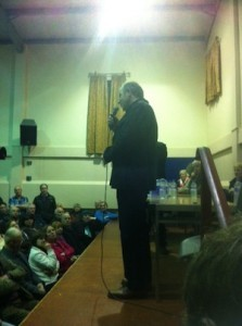 An emotional Tom McKean, nephew of Suzy and Isa Arthur, speaks at the meeting.
