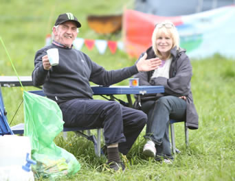 Two veteran Scouters Tony Smith (Killybegs) and Geradline Coughlin (Donegal Town) with more years service than they care to rememeber enjoying a relaxing camp. ((c) North West Newspix)