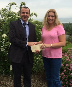 Brian Sweeney PRO Loughside Community presents a cheque to Janet Russell Cashelshanaghan NS