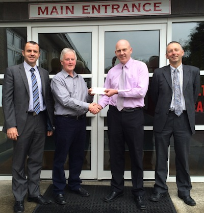 Conor Crossan Secretary Loughside Community presents a cheque to Kevin Caldwell Woodland NS. Also in the picture Brian Sweeney, PRO and Cathal Roarty Treasurer Loughside Community
