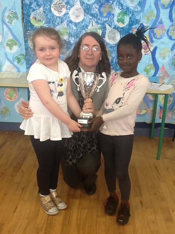 Cultural award for rural respecting difference programme with junior infant winners Sarah and Zelda.