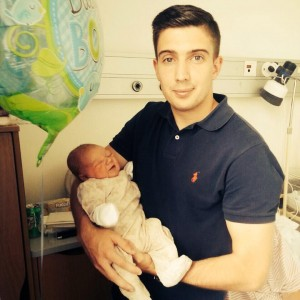 Proud dad Shaun Kelly holding his son Luca who was born last week.