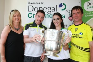 Bridgid Mc Dyre winner of the Donegal's best supporter pictured with Donegal's Martin Reilly and Asst Donegal Manager John Duffy pictured as they celebrate with the Anglo Celt Cup when they met up at Principal Sponsor Donegal Creameries Headquarters at the Crossroad,  Killygordan. The are pictured with Donegal Creameries representative  Breege Linsay Photo Cristeph/Brian McDaid