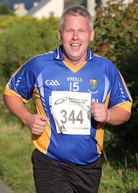 Kieran Neeson enjoying the run as he enters the closing stages of the St. Johnston 5K Road Race. Pic.: Gary Foy