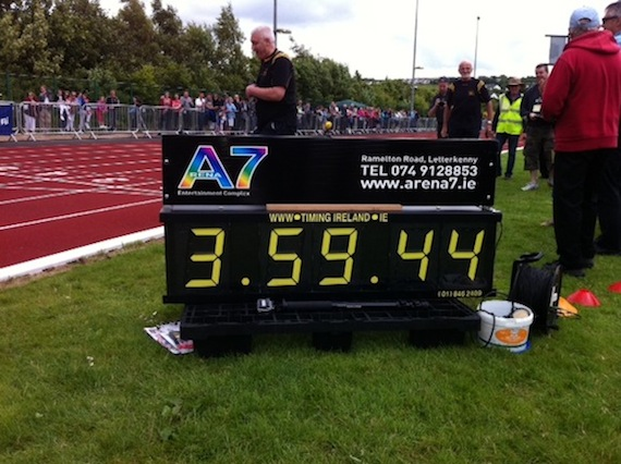Herbie McDaid and Danny McDaid realise they've done it as the clock shows the four minute mile has been broken!