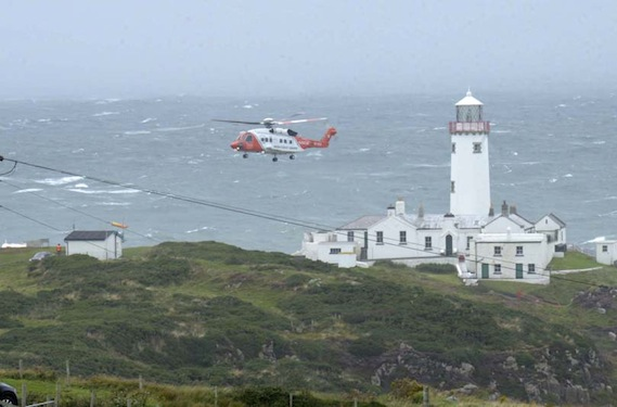 The scene at Fanad Lighthouse in north Donegal this afternoon as the Irish Coast Guard Rescue helicopter taking the victim ashore following a search and rescue operation. Photo by John McAteer.