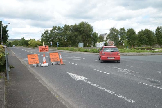 The roadsigns diverting traffic away from Milford which have left traders outraged.