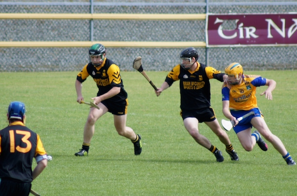 """""""Conor O'Donnell and Colm Flood (St. Eunan's) contest possession with Christopher McDermott (Burt)"""""""