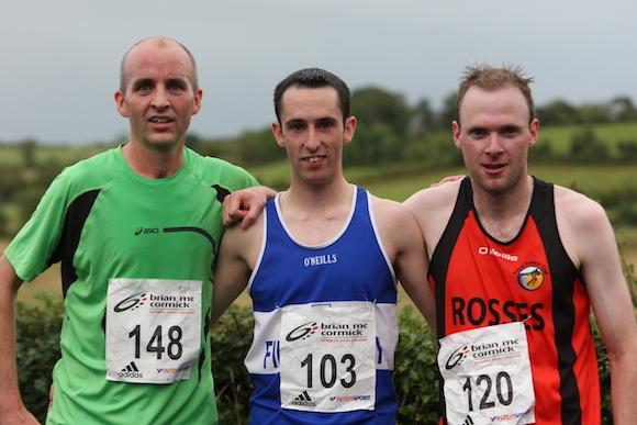 Top three men in the Ballyare 10k L-R Ciaran Mc Gonagle Rosses AC 1st Gerard Gallagher FVAC 3rd Noel Diver Rosses AC 2014 4M1J3679