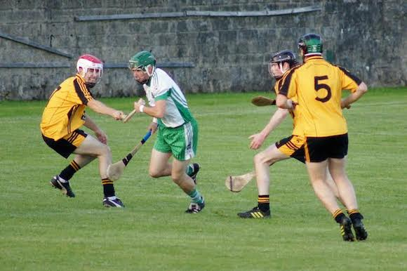 Lee Henderson under pressure from Conor Parke, Stephen Doherty and Conor O'Donnell