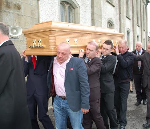 The remains enter the Church carried by Marcus White, Paul Kennedy, David Giblin and Edward Gilligan