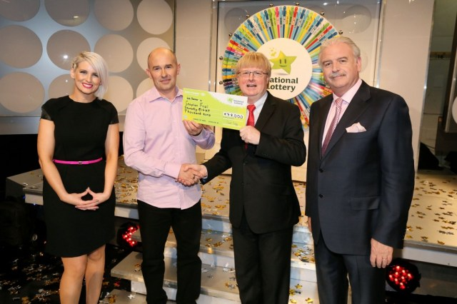 Stephen Friel from Kilmacrennan, Co. Donegal who won €78,000 including a car on last Saturday's National Lottery Winning Streak game show on RTE. Pictured at the presentation of winning cheques were from left: Sinead Kennedy, game show co-host;  Stephen Friel, the winning player; Eddie Banville, Head of Marketing, The National Lottery and Marty Whelan, game show co-host. The winning ticket was bought from Dunnes Stores. Pic: Mac Innes Photography