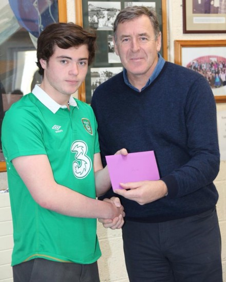 Packie Bonner making a presentation to James Boyle who's been selected to represent Ireland at the Football for all World cup in Mexico.