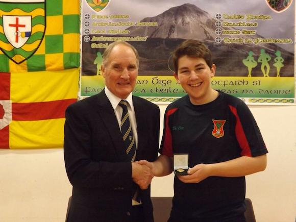 Michael White receiving his medal at the county scor final tonight. Michael will represent Carndonagh at the Ulster semi final on December 7th
