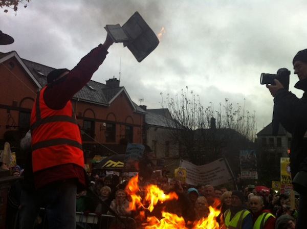 An Irish water application formed is burned at the protest march today. Pic by Donegal Daily.
