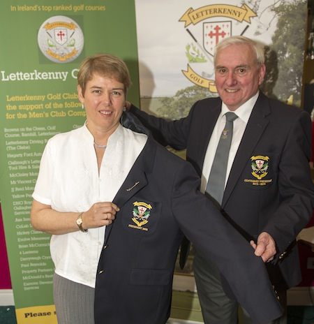 Outgoing President Barry Ramsay congratulating  Anne Condon  on her history making appointment as Letterkenny Golf Club President 2015. Barry helping Anne with her President's blazer.