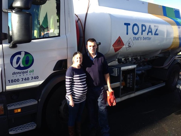 Patricia takes delivery of her free oil from Donegal Oil Company.
