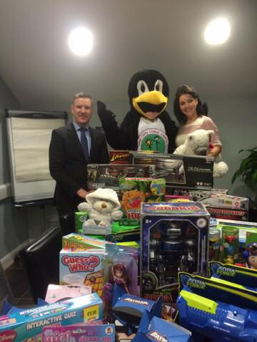 Liam McShea from Supervalu with Avril McMonagle from DCCC and some of the toys donated by you