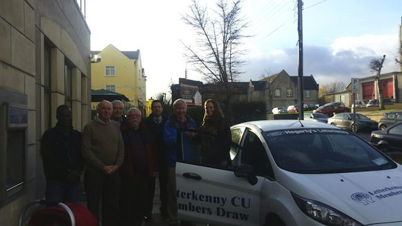 Members of Letterkenny Credit Union committee with Emma and her new car.