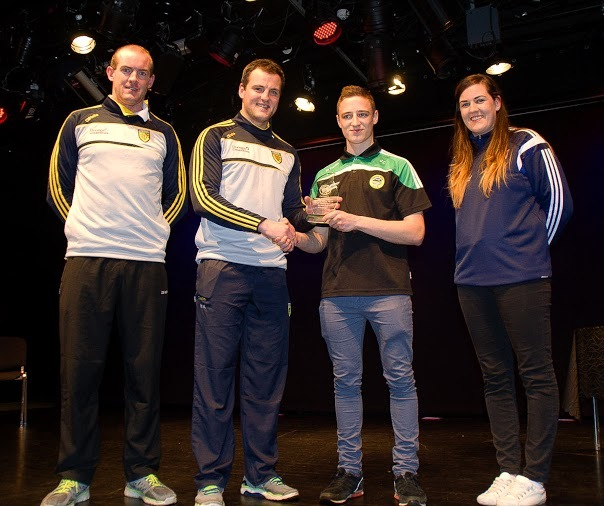 Cormac Callaghan receives The Special Achievment Award from Michael Murphy.