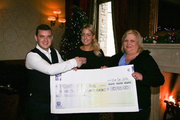 Danny O Carroll (From Mrs Brown's Boys) pictured at the presentation of nearly €10,915 which was raised at his Fundraising Party at the Mt Errigal Hotel. Pictured from left are Evelyn Smith representing the Children Pediatric  Comfort Fund Letterkenny General Hospital . Laura Jackson, events manager at the Mt Errigal Hotel.Photo By Brian McDaid