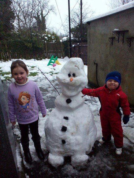 Little Adam and Annie enjoy the snow in Lifford. :)