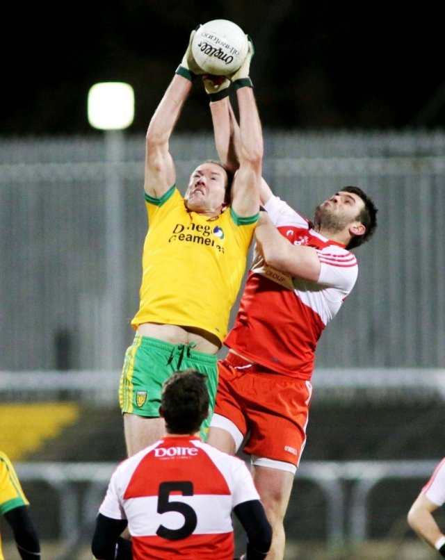 Neil Gallagher out-jumps the Derry midfielders to claim this high ball during Donegal's victory in the first match of their new National League campaign
