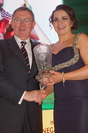 Sean O'Rourke presents Termon's Geraldine McLaughlin with the Brendan McDaid Memorial Special Achievement Award