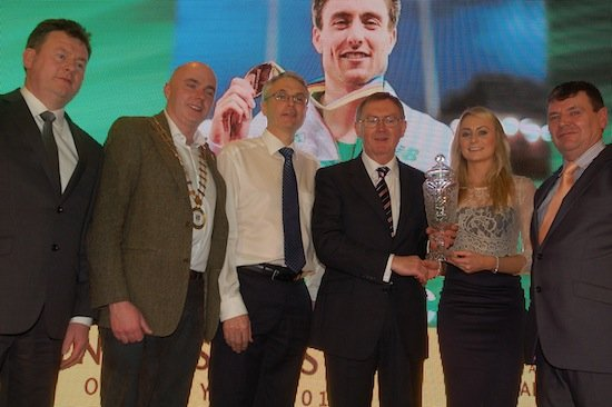 Michelle English accepts the 2014 Overall Donegal Sports Star Award on behalf of Mark English from special guest Sean O'Rourke. Also included are Council Chief Executive Seamus Neely,Cathaoirleach Cllr John Campbell and Sports Star Chairperson Neil Martin