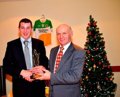 Rodger Mc Daid presents Charlie Bonner with the  Reserve team player of the year.