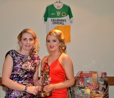 Martina Mc Grenra of County Dry Cleaners presents Young lady player of the year to Catriona Boyle.