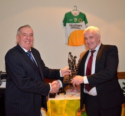 Billy Mc Daid receives Senior Player of the Year on behalf of Aidan Mc Devitt from Jamsie Doherty at the Glenswilly Gaa Presentation Night.