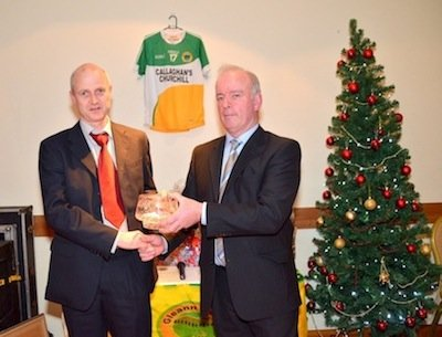 John Mc Ginley receives Club Person of the Year Award from Glenswilly Club Chairman Mick Murphy.