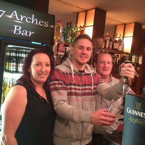 Jason with landlords Geraldine and Trevor Love at the 7 Arches Bar in Laghey.