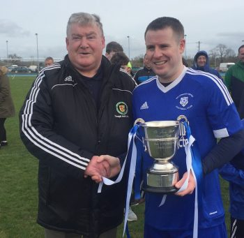 Ballybofey United captain Damien Glackin receives the CT Ball Division Two cup from Terry Leyden.