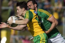 Eoin McHugh under pressure from Meath's Graham Reilly during Saturday's game. Photo Evan Logan