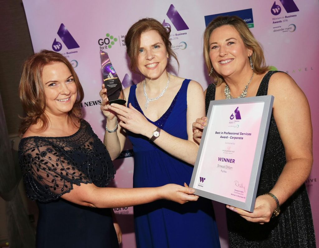 Darina Armstrong from Progressive Building Society and Roseann Kelly from Women in Business present Fujitsu's Sinead Dillon (centre) with the Women in Business Award for Best in Professional Services, Corporate.