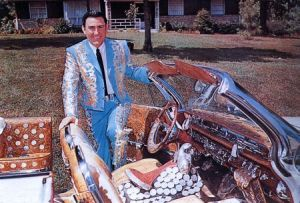 UNSPECIFIED - JANUARY 01: (AUSTRALIA OUT) Photo of Webb PIERCE; Posed portrait of Webb Pierce, with car (Photo by GAB Archive/Redferns)