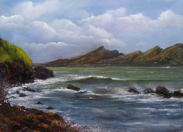 Peaked mountain range oftentimes referred to as the Three Sisters, with sea crashing against the rocks, Dingle peninsula, Atlantic coast