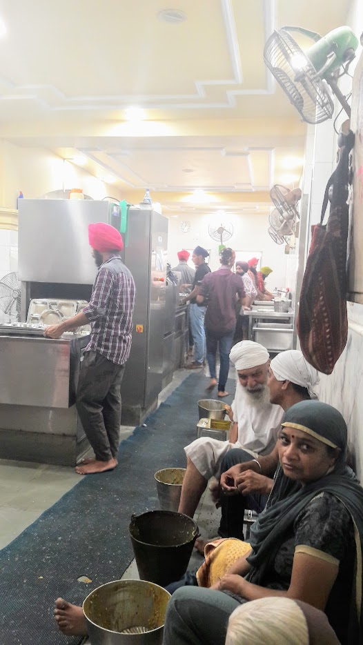 Sikh temple - peeling the veg