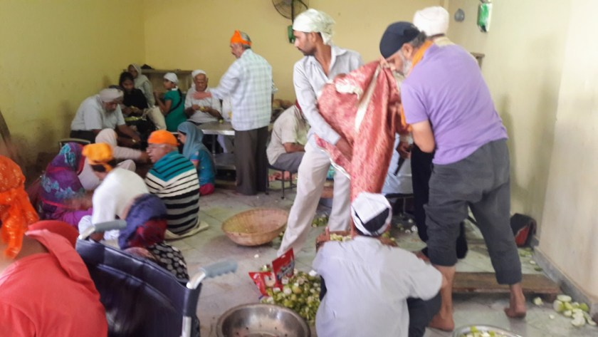 Sikh Temple - Food Preparation where sacks of grain are emptied