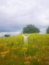 Donna McGee lovin the wild flower garden