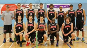 Photo of Donoghue Solicitors sponsor sign with Liverpool Basketball Club Men's Team in their new kits.