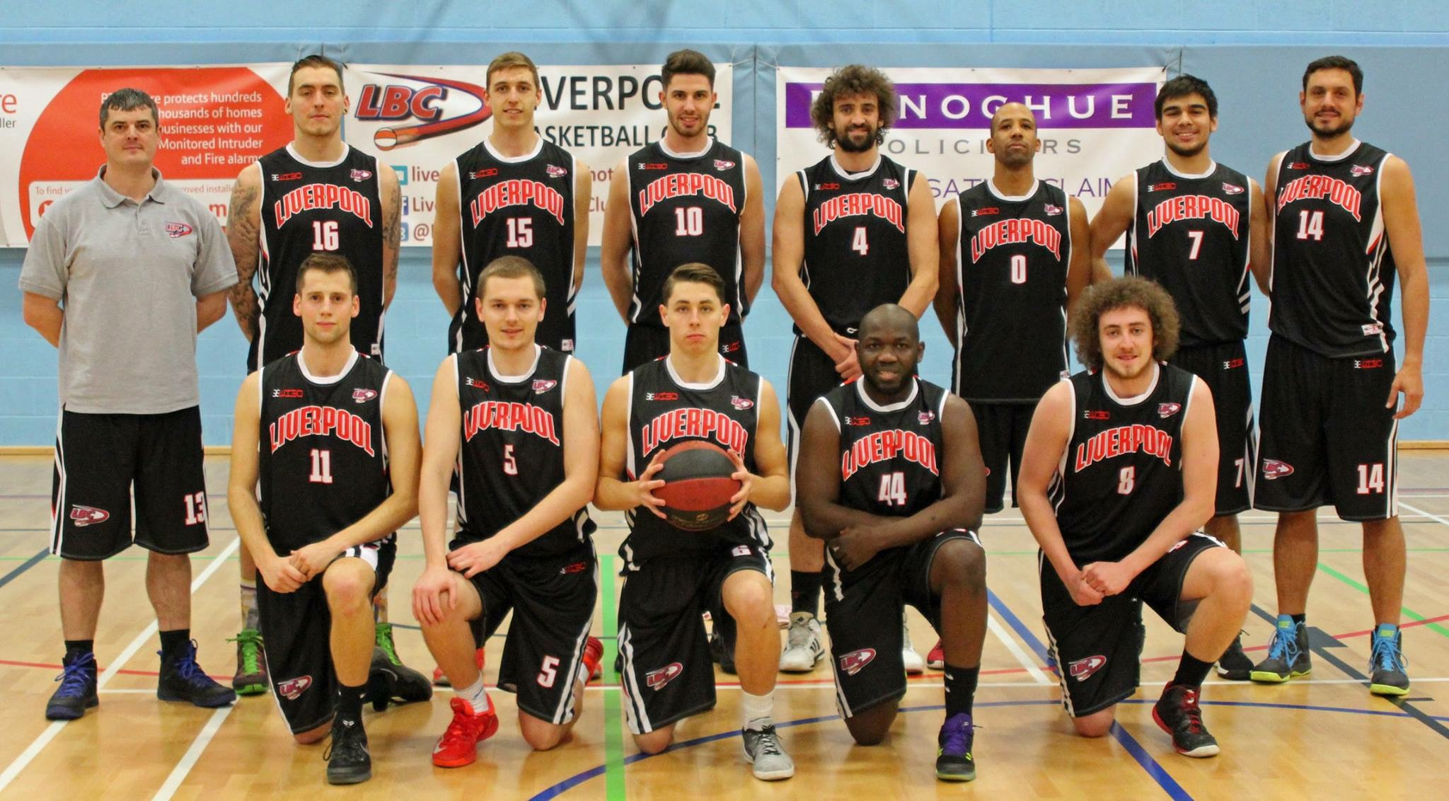 69c26b27b983ef Liverpool Basketball Club Men's Team in their new kit in front of the  Donoghue Solicitors sponsor sign.