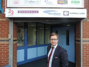 Photo of Kevin Donoghue Solicitor in Bootle at the entrance to Brunswick Youth Club.