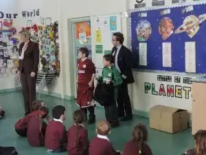 Photo of Kevin Donoghue, Solicitor, presents the football kits to Orrets Meadow School at a special assembly,