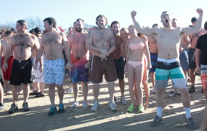 Swimmers get pumped for the 18th Annual Monument Beach polar plunge.